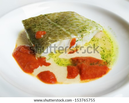 Cod in green sauce and tomato sauce, Basque cookery. - stock photo