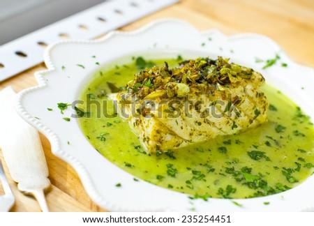 Cod in green sauce (Bacalao en salsa verde). Basque cuisine. - stock photo