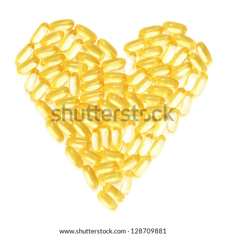 Cod liver fish oil supplements in a healthy heart shape - stock photo