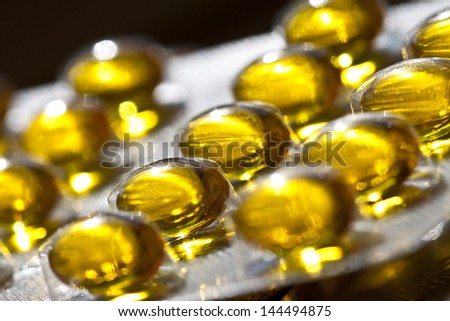 Cod liver oil omega 3 gel capsules isolated on pastel background. Vitamin D capsuls. blister pack with vitamins. Pharmaceutical - stock photo