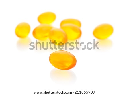 Cod liver oil omega 3 gel capsules isolated on white background - stock photo