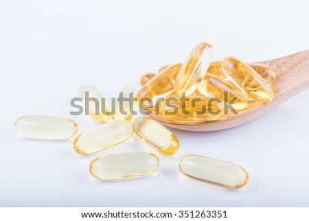 Cod liver oil omega 3 gel capsules on white background - stock photo
