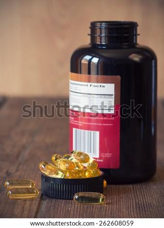 Cod liver oil omega 3 gel capsules. Selective focus, shallow DOF - stock photo
