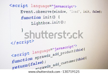 Code of JavaScript language on LCD screen - stock photo