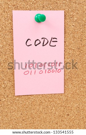 Code word and symbol drawn on paper and pinned on cork board