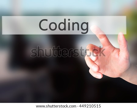 Coding - Hand pressing a button on blurred background concept . Business, technology, internet concept. Stock Photo