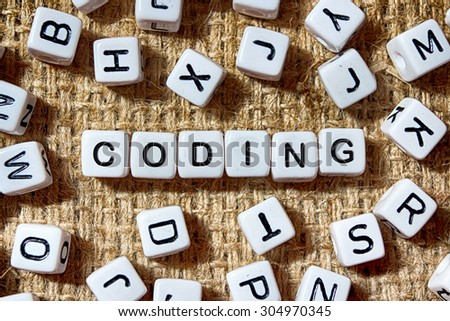 CODING word on white blocks concept - stock photo