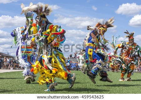 Coeur d'Alene, Idaho USA - 07-23-2016. Stepping out at the powwow.  Young dancers participate in the Julyamsh Powwow on July 23, 2016 in Coeur d'Alene, Idaho.