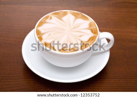 Cofee cup with coffee beans background - stock photo