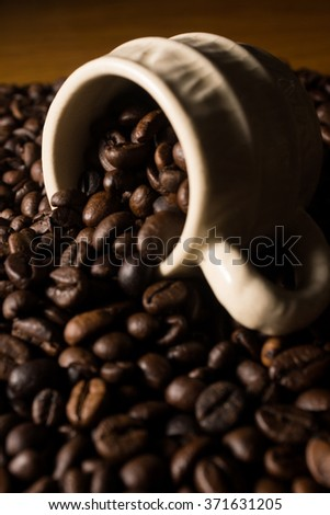 Coffe beans and cup. High resolution image.