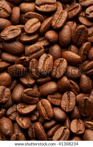 Coffe beans background, macro closeup - stock photo
