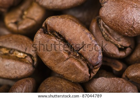 coffe beans close up on wood table - stock photo