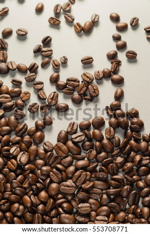 Coffe beans on Neutral Gray Background. Dark Roast Coffee.