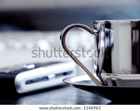 Coffe cup on the work desk - stock photo
