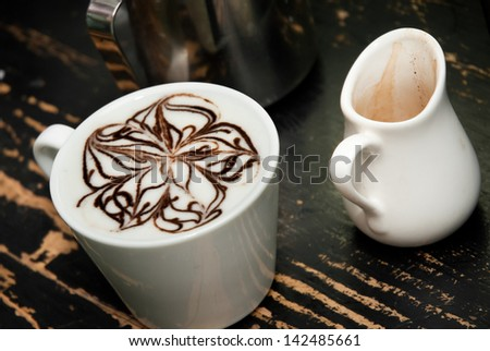 coffe espresso compano cup on the black background - stock photo
