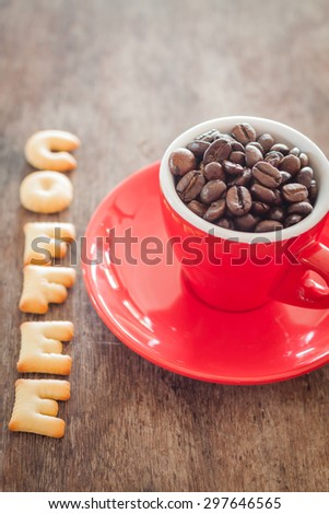Coffee alphabet biscuit with red coffee cup, stock photo - stock photo