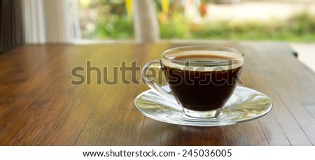 coffee americano in a glass on wood - stock photo