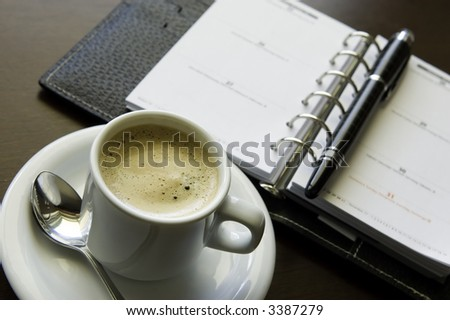 Coffee and Agenda - stock photo