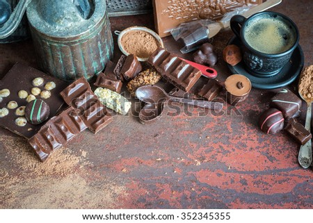 Coffee and assorted chocolate, selective focus, space for text