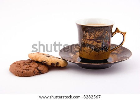 Coffee and biscuits on white - stock photo