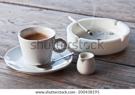 coffee and burning cigarette in the photo - stock photo