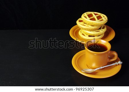Coffee and cakes.Black background