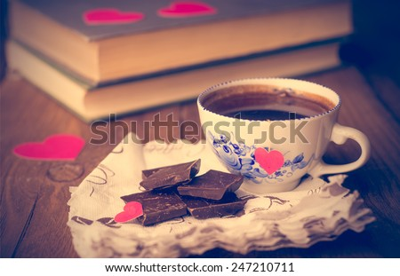 Coffee and chocolate, in the background of the heart from the carton. Valentine's Day. Retouching in retro style