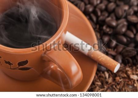 Coffee and cigarette - stock photo