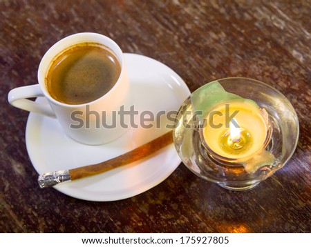 coffee and  cinnamon with candle on table - stock photo