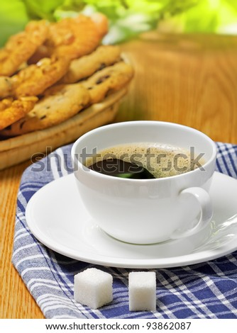 Coffee and cookies on the table, outdoor - stock photo