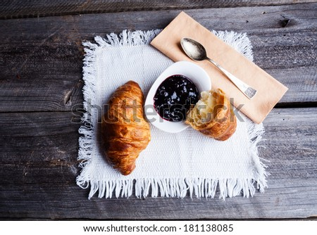 coffee and croissant. breakfast table - stock photo