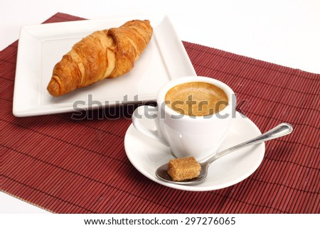 Coffee and croissants close up shallow dof - stock photo