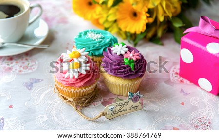 Coffee and cupcakes for Mother's Day with flowers and present