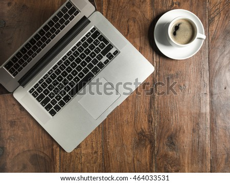 coffee and laptop on the office desk