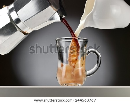 Coffee and milk flow in a glass - stock photo