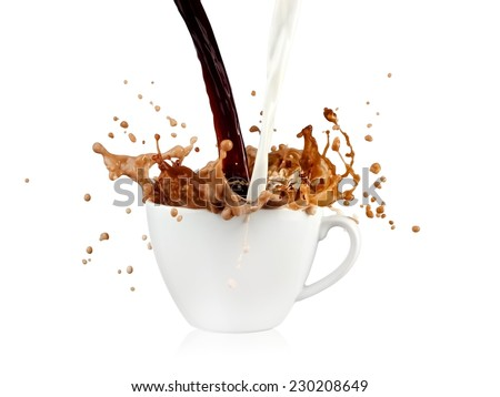 Coffee and milk pour and up from a cup - stock photo