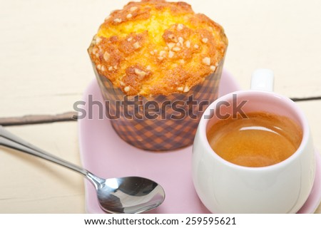 coffee and muffin served on a pink heart shaped dish - stock photo