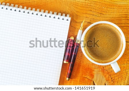 coffee and note on wooden background - stock photo