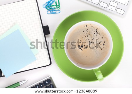 Coffee and office supplies. View from above. Closeup on white background