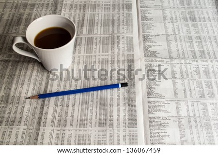 coffee and pencil on newspaper - stock photo