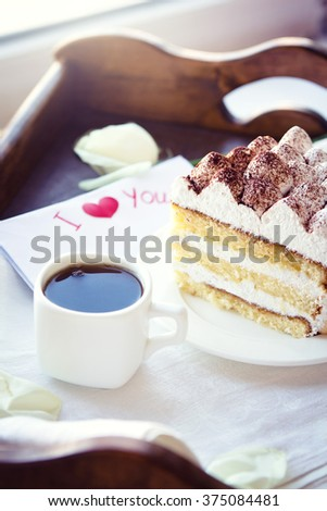 Coffee and tiramisu on the tray