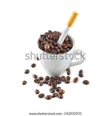 Coffee and tobacco: cigarette in a cup full of beans isolated over white background - stock photo