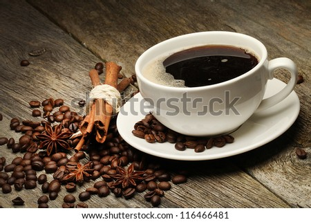 Coffee background with beans and white cup. - stock photo