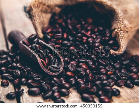 Coffee, bag and scoop on old rusty background - stock photo