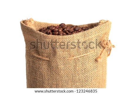 Coffee bag made from burlap fully filled with coffee beans. Isolated on white background.
