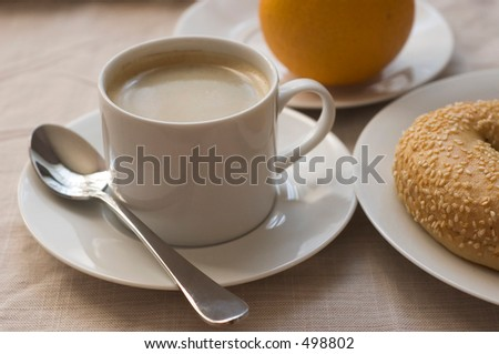 coffee, bagel, orange breakfast - stock photo