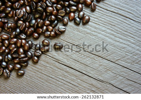 Coffee bean background on wooden texture, brown cafe beans and grey color can make amazing, simple frame