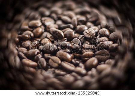 Coffee bean black border and motion blur - stock photo