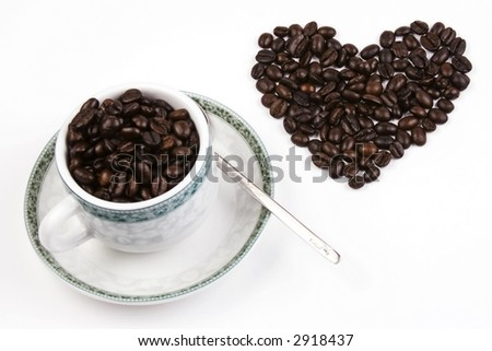 Coffee bean in love shape with cup.