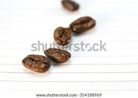 coffee bean on recycle paper background - stock photo